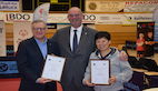 President KRAMER presented Badge of Honour to André HARTMANN and NI Xia Lian